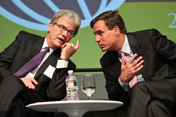 Tom Coburn and Mark Warner exchange views at the 2012 Bretton Woods Committee Annual Meeting