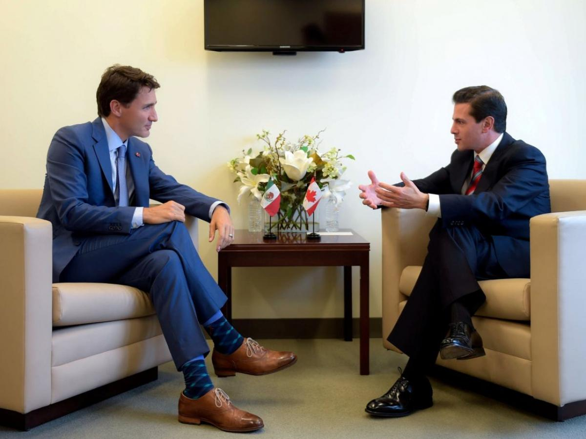 Canadian Prime Minister Justin Trudeau and Mexican President Enrique Peña Nieto chatting on the sidelines of the U.N. General Assembly this week. No meeting occurred between Mr. Trudeau and President Trump amid stark trade differences. PHOTO: HANDOUT/REUTERS