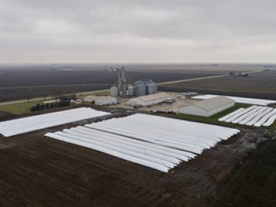 EU officials hope market forces will boost some U.S. exports, such as soybeans, providing breathing room as talks continue. Bags of corn and soybeans at Gingerich Farms in Lovington, Ill. DANIEL ACKER/BLOOMBERG NEWS